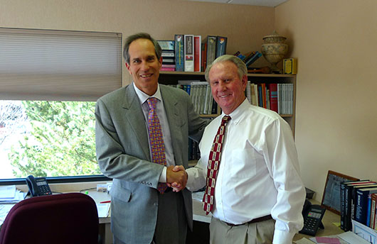 Dr. Larry Cole congratulating Ted Link for another successful lease at 3245 International Drive